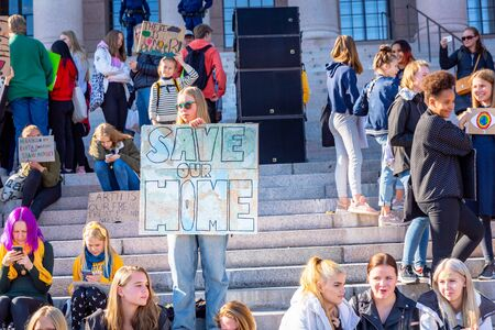 Helsinki, Finland - September 27 2019: Young students gather in climate change protest rally, School Strike 4 Climate, and demand urgent action on climate change.