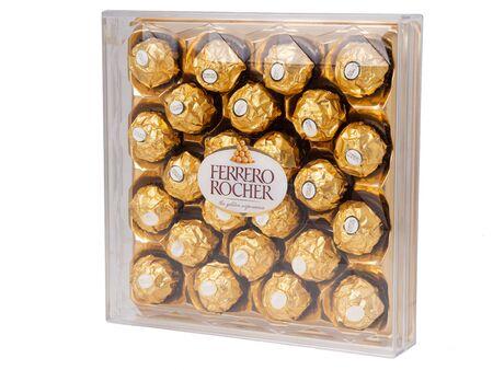 KHABAROVSK, RUSSIA - JUNE 28, 2018: Big plastic  Box of chocolates Ferrero Rocher - Chocolate sweets with whole hazelnuts. Produced by the Italian company Ferrero.