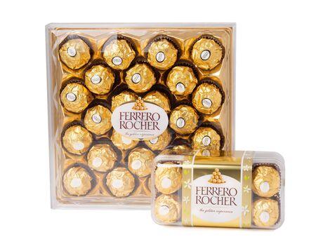 KHABAROVSK, RUSSIA - JUNE 28, 2018: Two  Box of chocolates Ferrero Rocher - Chocolate sweets with whole hazelnuts. Produced by the Italian company Ferrero.
