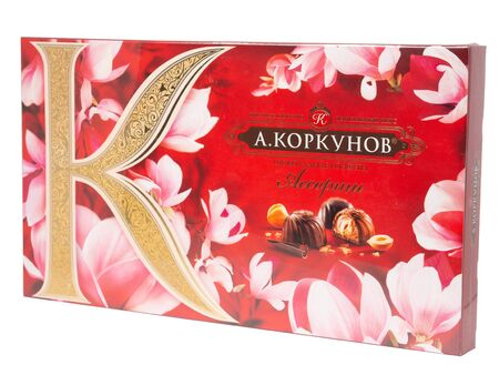 KHABAROVSK, RUSSIA - JUNE 28, 2018: Russian Sweets A. Korkunov - Assorted dark and milk chocolate with whole hazelnuts.