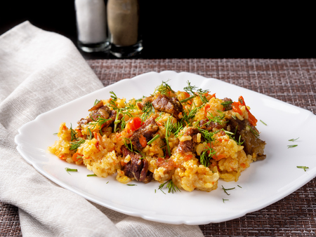 traditional pilaf on a white plate Standard-Bild - 117117677