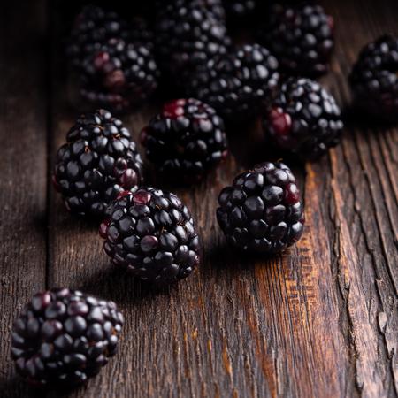 blackberry on dark brown wooden background. Well suited for the catalog. Standard-Bild - 117117716