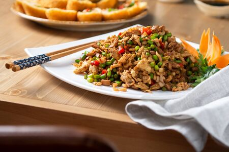 Chinese meat on a white plate. Asian cuisine. Standard-Bild - 131069903