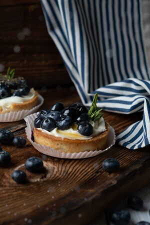 Tartlets with delicate cream and blueberries.
