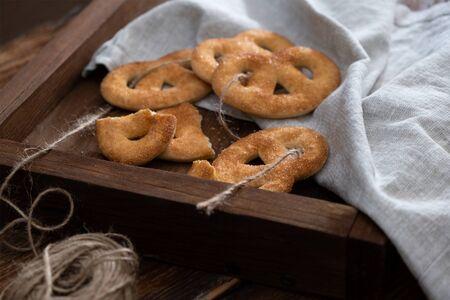 Sugar pretzels on a wooden tray
