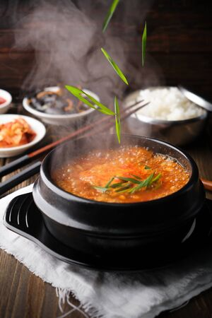 Very hot spicy korean soup yukgaejang gukbap is korea traditional soup with beef, flying greens, vertical,
