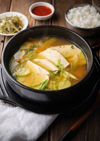 Hot korean tofu soup (tubu). Vertical