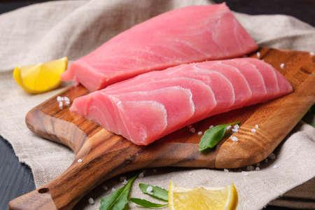 Fresh tuna fillet on a wooden board.