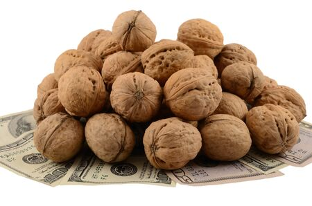 Mountain of nuts on dollars