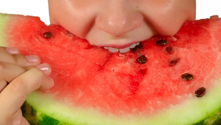 The child eat a ripe juicy red watermelon Stock Photo