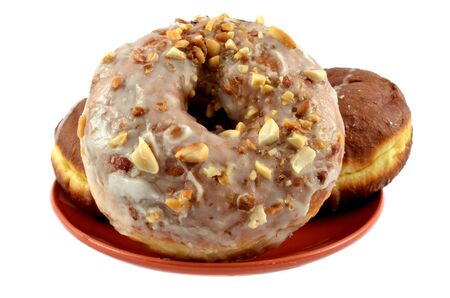 Doughnuts with glaze and nutlets Stock Photo