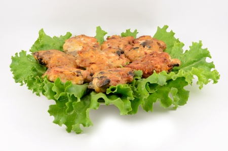Cutlets minced on leaves of salad