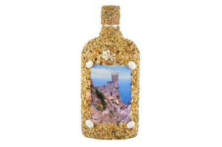 Bottle of sea pebbles and shells
