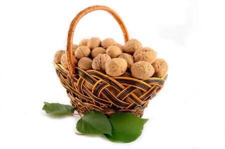 Basket full of nuts isolated on white background Stock Photo - 15582316