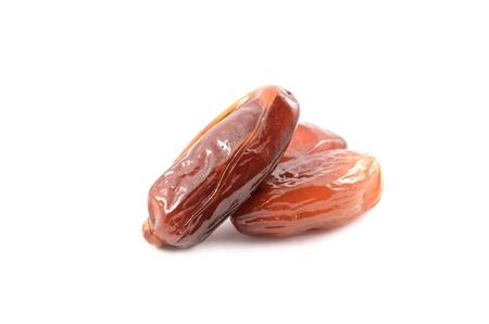 Fragrant ripe dried dates closeup on white background Stock Photo - 15709628