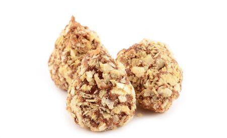 Truffle chocolates close-up on an isolated white background