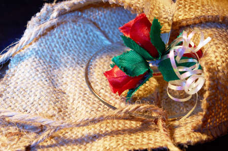 baggy: Artificial  red flowers against  the background of baggy fabric Stock Photo