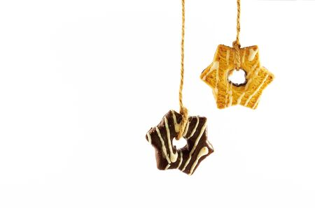 Shortbread cookies with milk and chocolate glaze hanging on a rope on a white background Stock Photo - 16686333