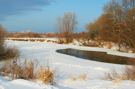 River covered with snow winter frosty morning