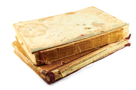 Old battered books on a white background photo
