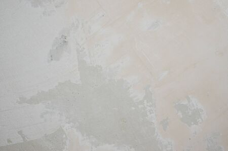 concrete surface finishing: Concrete wall covered with putty as natural background