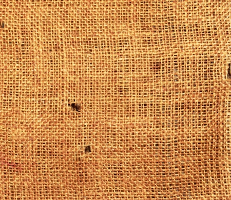 flaxen: Old torn flaxen sackcloth as natural background
