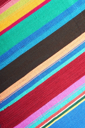 New textile fabric in multicolored stripes as a natural background Stock Photo