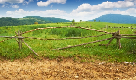 Old broken wooden fence in the mountains