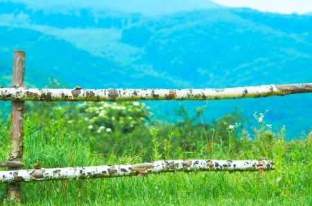 Wooden fence on pasture in the mountains