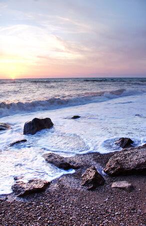 The sunset on the sea coast