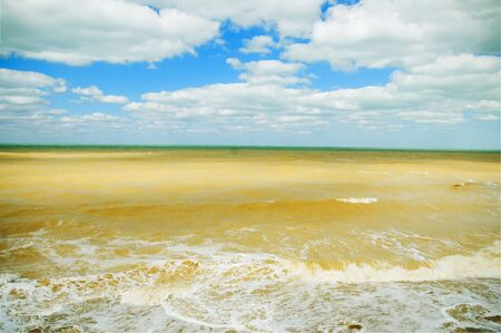 Dirty sea after storm summer day