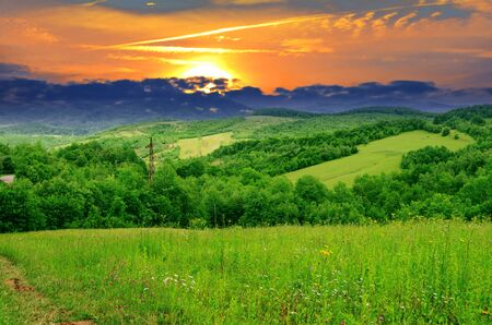 Sunset in the summer in the Carpathian Mountains Stock Photo