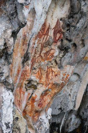 Prehistoric petroglyph rock paintings in Misool, Raja Ampat, West Papua, Indonesia by aborigines, 3,000 to 5,000 years ago Reklamní fotografie
