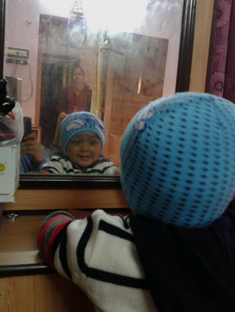 mirror: Mirror reflection of a child