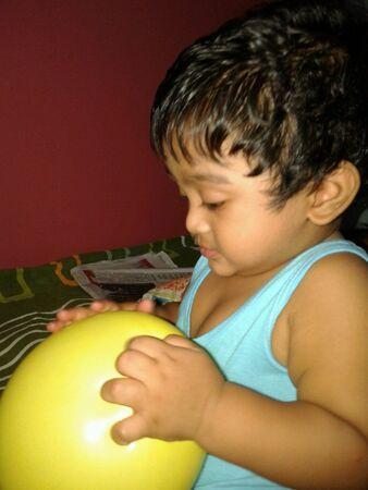 babyhood: Child with balloon Stock Photo