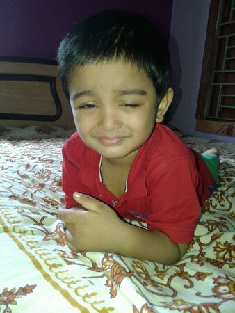 boyhood: A drowsy child on his bed in bedroom