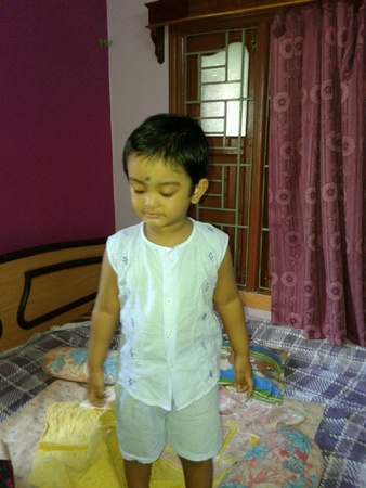 waited: A beautiful child waiting for his mother on the bed in bedroom