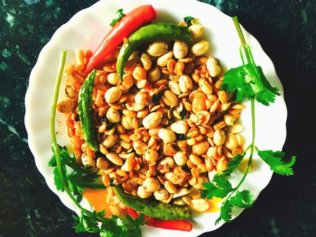 A plate of fried peanuts and soybeans