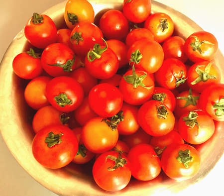 A large bowl of tomatoes Stock Photo