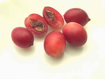 crimson colour: Some of crimson fruits or Carissa carandas
