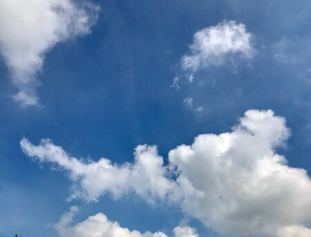 Beautiful natural scenery with cumulus clouds and clouds cartoon in the blue sky at the day time. Its a very nice cloudscape or nature landscape or natural scenery