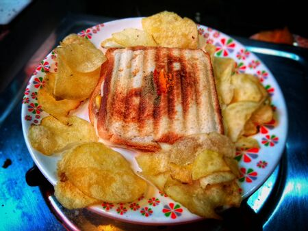 Bacon and Tomato Sandwich with potato chips