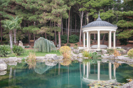 Antique gazebo in a park near a pond in high quality Stock Photo