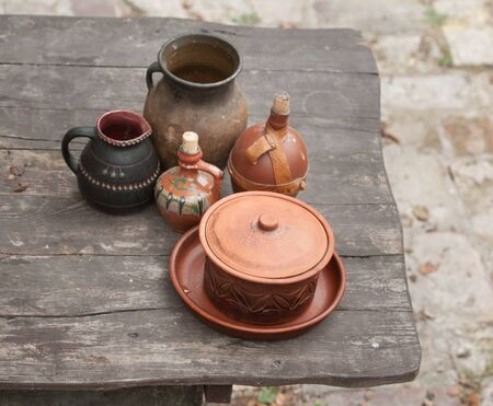 vintage pots on a wooden table in high quality