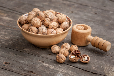 walnuts on a wooden table high quality