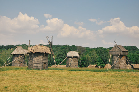 Vintage wooden windmills in the field in high quality