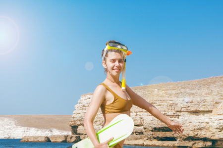 Beautiful girl in accessories for diving on the background of the sea. High quality Stok Fotoğraf