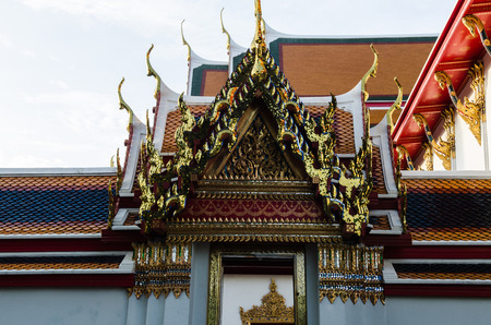 ancient yoga: Ornate roof of Wat Pho Temple in Thailand. Stock Photo