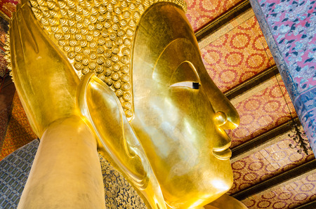recline: Gold Reclining Buddha at Wat Pho, Bangkok, Thailand.