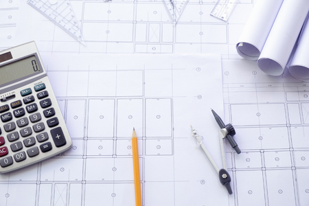 Workplace of architect - Architectural project, blueprints, blueprint rolls and divider compass on plans. Engineering tools view from the top. Construction background. Stock Photo